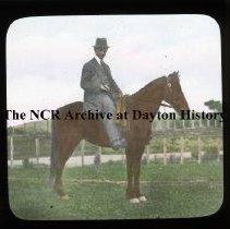 Image of NCR.1998.L0177.035 - Lantern Slides - Bombay, India - W.C. Howe on Horse