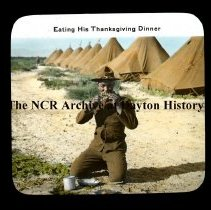 Image of NCR.1998.L0349.035 - Lantern Slides - 3rd Ohio Infantry, in TX near Mexican Border, circa 1918 - Eating His Thanksgiving Dinner