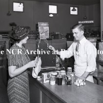 Image of NCR.1998.LRN133.003 - Nitrate Negative - Grocery - Minimax Stores(Check out) - Houston, TX - September 15, 1936