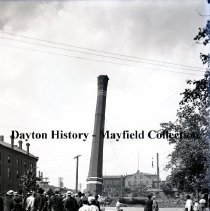 Image of P.2012.50.00199 - Glass-Plate Negative - Streets - Sixth St. Old smoke stack tear down for Excelisor Laundry Bldg.