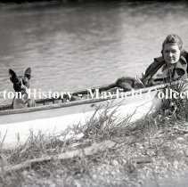 Image of P.2012.50.00674 - Glass-Plate Negative -  Unidentified woman & dog in canoe