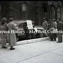 Image of Montgomery Co. Auto Dealers - Wrecked car, front of Sheriff's house - 1951