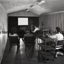 Image of P.2012.50.22529 - Negative, Film -   Film Associates, Inc. 440 E. Schantz Ave.   April 12, 1947 people viewing film in projection room .