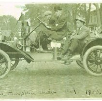 Image of Three men in 1910 Model-T Ford in the 1910 Pumpkin Show  parade - 12-15 Oct 1910