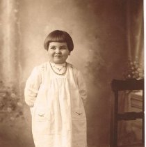 Image of Young girl approximately 4 years old posing for a portrait -