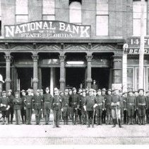 Image of 4th Illinois Provost Guard in front of National Bank - 1898