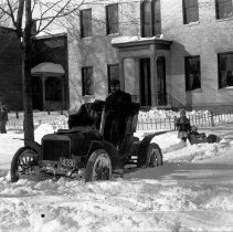 Image of 65 East Winter Street in winter with Ford Model T(?) -