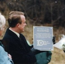 Image of Thomas Homan presenting plaque