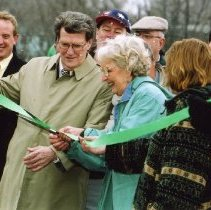 Image of Tom Homan, George Speese, and Marge Matthews cutting the ribbon