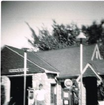 Image of Dee's Gulf Service Station; George Downing may be pumping gas - 1951