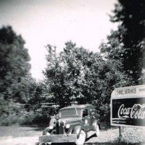 Image of Dodge panel truck near Dee's Gulf Service station - 1951