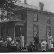 Image of American Family in front of their house in December 1909