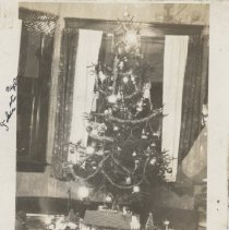 Image of John's Christmas Tree and Electric Trains 1928 - Photograph of Christmas tree with Lionel standard gauge toy trains and Lionel #121, type II, station.