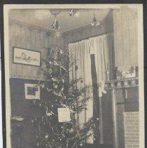 Image of 1920 Photo of Windup Train Set Under Christmas Tree - Christmas 1920 photo of small windup train set under Christmas tree.
