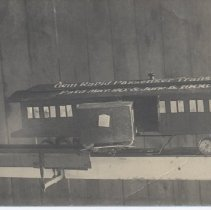 Image of Gem Rapid Passenger Transfer Car - Photo postcard of a model of a Gem Rapid Passenger Transfer car, patented March 20 and June 5, 1906, sent to Mattie McMahon in Shermaplis, WY.  The system was intended to be a method of transfering passengers between coaches.