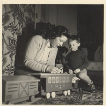 Image of German Boy and Mother with Ride-on Train - 1956 German photo of  Fredy end his mother with ride-on /pull toy train.