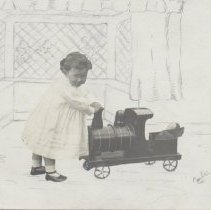 Image of Child in White Gown with Ride-On Locomotive - Child in foreground  pushes toy ride-on locomotive.  Background is pencil sketch