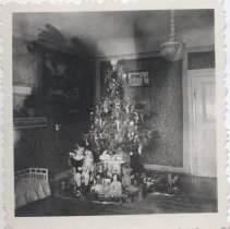 Image of Christmas Tree with Gifts and Toy Trains Weinachten 1936 - Photo of Christmas tree with toy trains and presents.