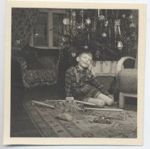 Image of Boy at Christmas in Lederhosen with Wooden Train Set - Small photo of boy with wooden trains and cars at Christmas.  Technofix mountain railroad set, made in Germany.