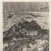 Image of Elaborate German Layout - Elaborate HO gauge train layout with buildings, factories, bridge and scenery.