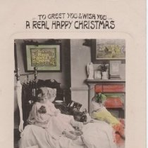 """Image of To Wish You a Real Happy Christmas - Christmas postcard circa1910.  Colorized. """"To Greet You and Wish You a Real Happy Christmas."""" To Miss Dora Ecklund of  Fresno, CA. Photo of boy and girl with doll, large toy locomotive, and dollhouse."""