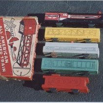 Image of All American Toy Train by Miller & Gray Company - Photos of  All American Toy trains by Miller & Gray Co.   Freight and passenger sets made of wood with paper lithography.   Circa 1940.
