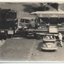Image of VW Cabriolet Waits While Freight Train Passes - Closeup shot of scene on layout.  A VW Cabriolet waits while a freight train passes.  German photo.