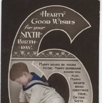 "Image of Sixth Birthday Postcard - British postcard for 6 year old boy.  ""Hearty Good Wishes for Your 6th Birthday.""  Shows boy in sailor suit playing with Hornby train set. Sent from London to Derbyshire.  Card states ""British Manufacture."""