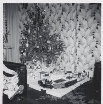 Image of Small Layout Unde Christmas tree. - Small layout under Christmas tree, Lionel scout train with Plasticville buildings.