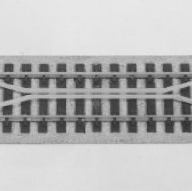 Image of American Flyer HO Pikemaster uncoupling track - American Flyer HO Pikemaster uncoupling track, Catalog # 24729.  This is an A. C. Gilbert catalog photograph.  List price of the item shown was $0.98  in 1963.