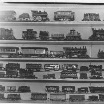 Image of Toy Train Collection - Photo. of unidentified toy tran collection.  Photo for Quarterly.   Corner faded.