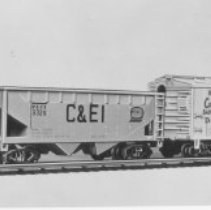 """Image of American Flyer HO """"Dispatcher"""" freight set - American Flyer HO train set with industrial Transfer Service diesel switcher, C&EI hopper, D&RGW Cookie Box boxcar & B&O caboose.  Included power pack and track is not shown in the picture.  Catalog # 30505.  This is an A. C. Gilbert catalog photograph.  List price of the item shown was $19.98  in 1960."""