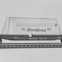 Image of American Flyer HO Bordens Milk Transport Car - American Flyer HO Bordens Milk Transport Car, tank on flat car lettered National Car Co., catalog # 33537.