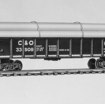 Image of American Flyer HO C&O pipe car - American Flyer HO Chesepeake & Ohio gondola with pipe load, black with white lettering, catalog # 33508.  This is an A. C. Gilbert catalog photograph.  List price of the item shown was $3.95  in 1958.