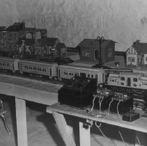 "Image of Lionel Passenger Set and Buildings on Layout - Lionel Standard Gauge layout with 408E locomotive, 429 combine, 43 diner and 428 pullman (Parlor car).  Two type ""K"" transformers and a type ""V"" transformer.  A smaller O gauge loop on the upper level."