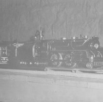 Image of Locomotive on Layout - Locomotive on layout.  Lionel Standard Gauge # 384 Steam locomotive with #380 electric locomotive in background.