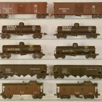 Image of Print from Lionel Collector's Guide - Print from McComas & Tuohy's  A COLLECTOR'S GUIDE AND HISTORY TO LIONEL TRAINS, Volume 1 Prewar O gauge.  Scale and semi-scale freight cars:  Top row;  2954 semi-scale box car, 714K scale box car (the K suffix indicates it was built from a kit).  Second row;  2955 semi-scale Shell tank car, 715 scale Shell tank car.  Third row;  2955 semi-scale Sunoco tank car, 715 scale Sunoco tank car.  Fourth row;  2956 semi-scale hopper car, 716 scale hopper car.  Bottom row;  2957 semi-scale caboose, 717 scale caboose.