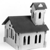 """Image of Bumpalow Town Buildings - Bumpalow Town Buildings by Milton Bradley c. 1931.  This is a rear view of the church.  They were made of four ply fiberboard and were assembled using tab and slot construction.  The church was 7"""" high, 8"""" wide and 6.75"""" deep.  They were sold in a set of six (cottage, school, house, church, store & garage) and as individual buildings."""