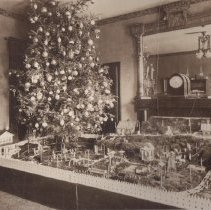 Image of Very Large Christmas Layout in Victorian Home - Enormous Christmas layout which takes up large section of  Victorian parlor. Steam locomotive is a Georges Carette Nuremberg model 965754, gauge 2 with a gauge 2 passenger set.  See this site for more Georges Carette information.  http://www.tcawestern.org/carette.htm