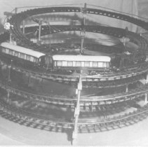 Image of Toy Train Set on Spiral of Track - Toy train runs on continuos spiral track.  Train consists of a tank locomotive (LNRR) and two passenger cars.