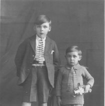 Image of Two Boys in Knee Socks w. Toy Locomotive - Older and younger boy in ties and knee socks.  Younger boy holds 
