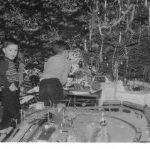 Image of What Should We Look At First?    - Photo of Wolfgang and Rainer, two German boys,  in Christmas scene with Marklin HO gauge layout.