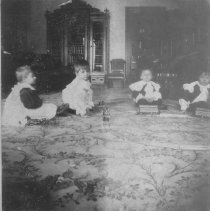 Image of Four Children on Floor with Toy Trains and Horse w. Cart - Very early photograph of 4 children sitting on the floor with toy trains (Issamayer No. 1 gauge clockwork) on track and a toy horse and cart. 1897.