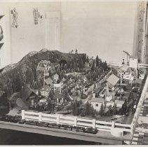Image of Large Lionel Layout in Child's Bedroom - Fantastic Lionel layout in child's bedroom.  Late 1940s. Includes Lionel Z transformer, 225E locomotive, 165 magnetic crane, 164 log loader, 313 bascule bridge, 154 automatic hiway signal, 47 double crossing gate & 45 or 46 crossing gateman.