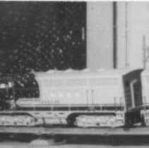 """Image of Marx Train Set - Note on back of the Photograph: """"Marx train Dottie and Buck bought for about $13.50 in January 1951 at Woodward and Lothroks.  Given to Johnny and Jerry Landrum, Christams 1951.  Marx, Santa Fe Super Chief freight set circa 1955-1956 with #21 engine (A & B), #44572 gondola, #1950 box car and #1951 caboose."""