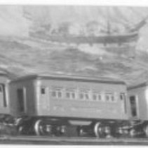 Image of Tinplate passenger cars - Tinplate passenger cars, to the left are Lionel O gauge cars 608 observation, & two 607 pullmans circa 1926.  To the right are American Flyer O gauge passenger cars circa 1926-1927, 3080 combination mail / baggage car and 3035 observation car.