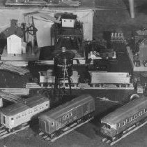Image of Train Collection - Set of 14 pictures from a collection of unknown origin.  (P2008.2.1 to P2008.2.14)  Lionel 126 station, 45 gateman, American Flyer magnetic crane, Lionel 265W tender, 607, 607 & 608 passenger cars, American Flyer O gauge passenger cars, and water tower.  A 249E in parts.