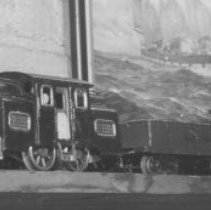 Image of Train Collection - Set of 14 pictures from a collection of unknown origin.  (P2008.2.1 to P2008.2.14)  Shown in this one are Lionel locomotives 38 & 33, freight cars 112, 114, 113 & 116.
