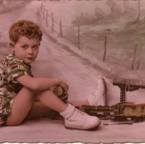 Image of Boy with Tain - Boy with train set of European design.