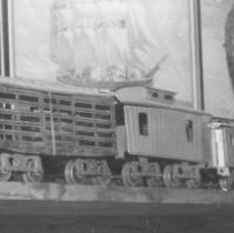 Image of Train Collection - Set of 14 pictures from a collection of unknown origin.  (P2008.2.1 to P2008.2.14)  Shown in this one are Lionel 14 box car, 13 stock car & 17 caboose.   Passenger cars are not identified.